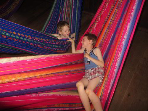 VACACIONES EN ECUADOR: Resting in hammocks at the Cofan Lodge when visiting the Amazon in Ecuador.