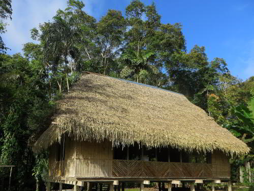 VACACIONES EN ECUADOR: Relaxing on the Cuyabeno Lodge deck during your Amazon visit in Ecuador