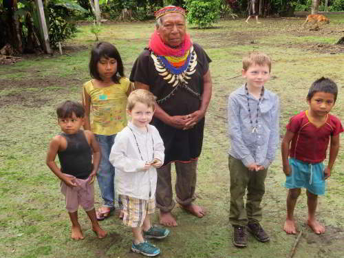 CUYABENO NATIONAL RESERVE [ECUADOR's AMAZON]: The Cofan shaman with children of the village and visitors.