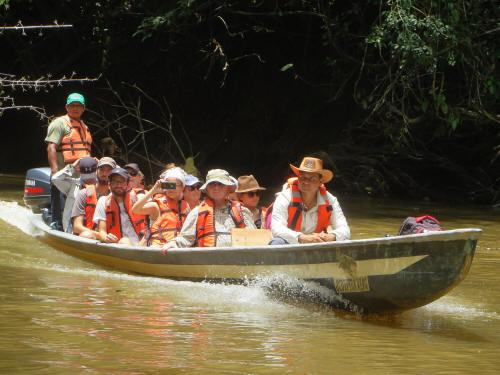 Indians take you in their agile dug-out canoes along winding rivers.