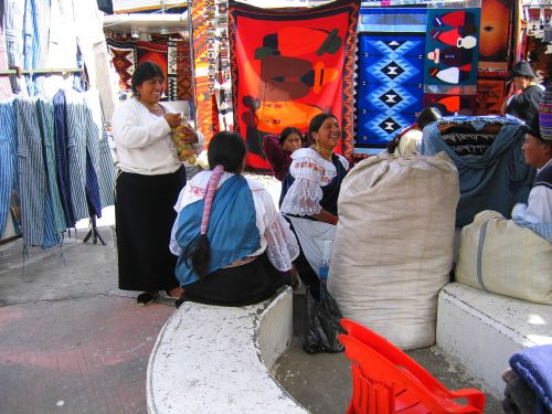 NATIONAL PARKS TOUR ECUADOR: Otavalo women at the Plaza de los Ponchos, Otavalo, Ecuador