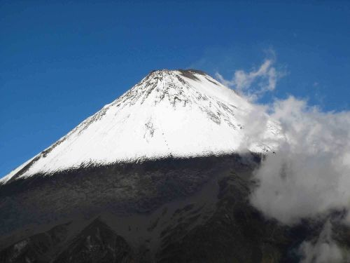 ECUADOR ANDES TREKKING TOUR [TREK TO 10 NATIONAL PARKS]: Chimborazo, seen on Andes treks in Ecuador.